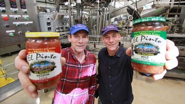 Jim and John Thomas show off their products at El Pinto.