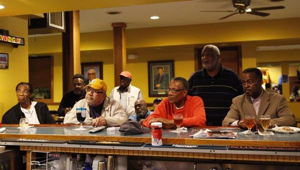 Members of the Monday Club watch as the grand jury's decision not to indict officer Darren Wilson in the shooting of Michael Brown in Ferguson, Mo. on Monday night.