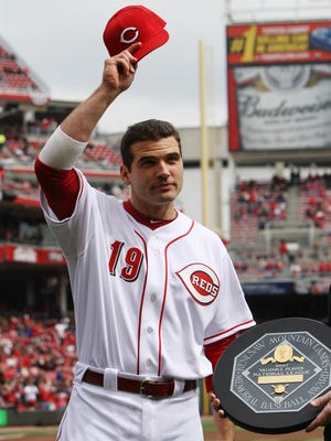 Cincinnati Reds first baseman Joey Votto (19) tips his hat after receiving the National League MVP trophy during a pre game ceremony on Opening Day at Great American Ball Park.