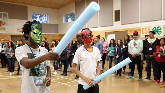 Tapiwa Kapurura, left, and Romeo Allen participate in a group exercise during ILEAD Youth Summit Saturday, Nov. 7, 2015, at the Oregon 4-H Center in Polk County.