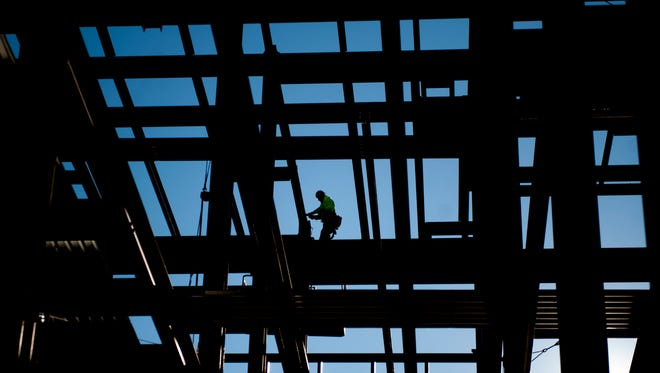 A construction worker works at the construction site of Rowan University's Rohrer College of Business in Glassboro prior to a beam signing ceremony held at the construction site on Wednesday.  01.06.16