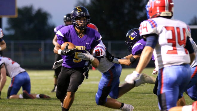 Unioto's Nehemiah Felts carries the football last Friday against Zane Trace at Unioto High School. Felts has caught 13 passes this season and averages 16.8 yards per reception.