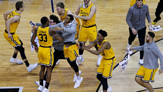 The UMBC Retrievers celebrate after beating top-seeded Virginia in the first round of the 2018 NCAA tournament.