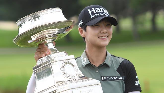 Sung Hyun Park poses with the trophy after winning the KPMG Women's PGA Championship at Kemper Lakes Golf Club in Kildeer, Ill.