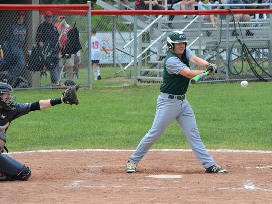 Pennfield's Adam Eyre takes a swing during district action vs Marshall on Saturday.