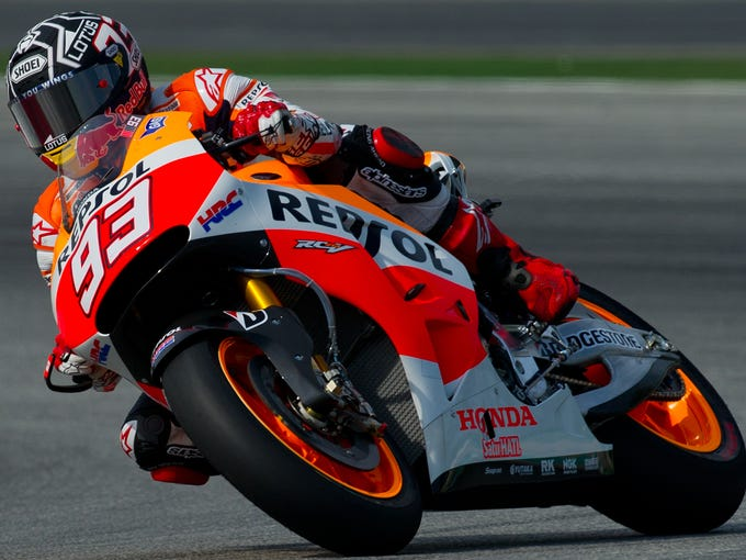 Repsol Honda Team's Spanish rider Marc Marquez steers his bike during the first MotoGP pre-season testing session on the second day at the Sepang circuit outside Kuala Lumpur on February 5, 2014. AFP PHOTO / MOHD RASFAN        (Photo credit should read MOHD RASFAN/AFP/Getty Images)