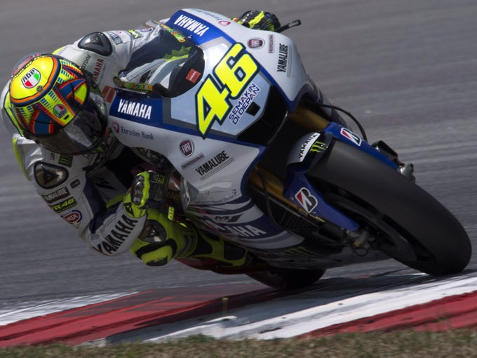 KUALA LUMPUR, MALAYSIA - FEBRUARY 28:  Valentino Rossi of Italy and Yamaha Factory Racing rounds the bend during the MotoGP Tests in Sepang - Day Three at Sepang Circuit on February 28, 2014 in Kuala Lumpur, Malaysia.  (Photo by Mirco Lazzari gp/Getty Images)
