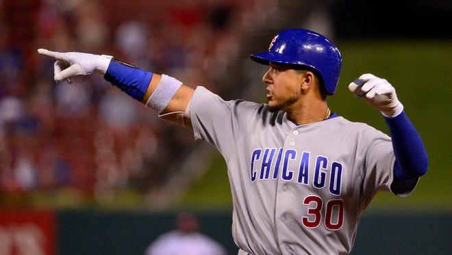 Chicago Cubs center fielder Jon Jay (30) celebrates after hitting a one-run single off of St. Louis Cardinals relief pitcher Sandy Alcantara (not pictured) during the eighth inning at Busch Stadium.
