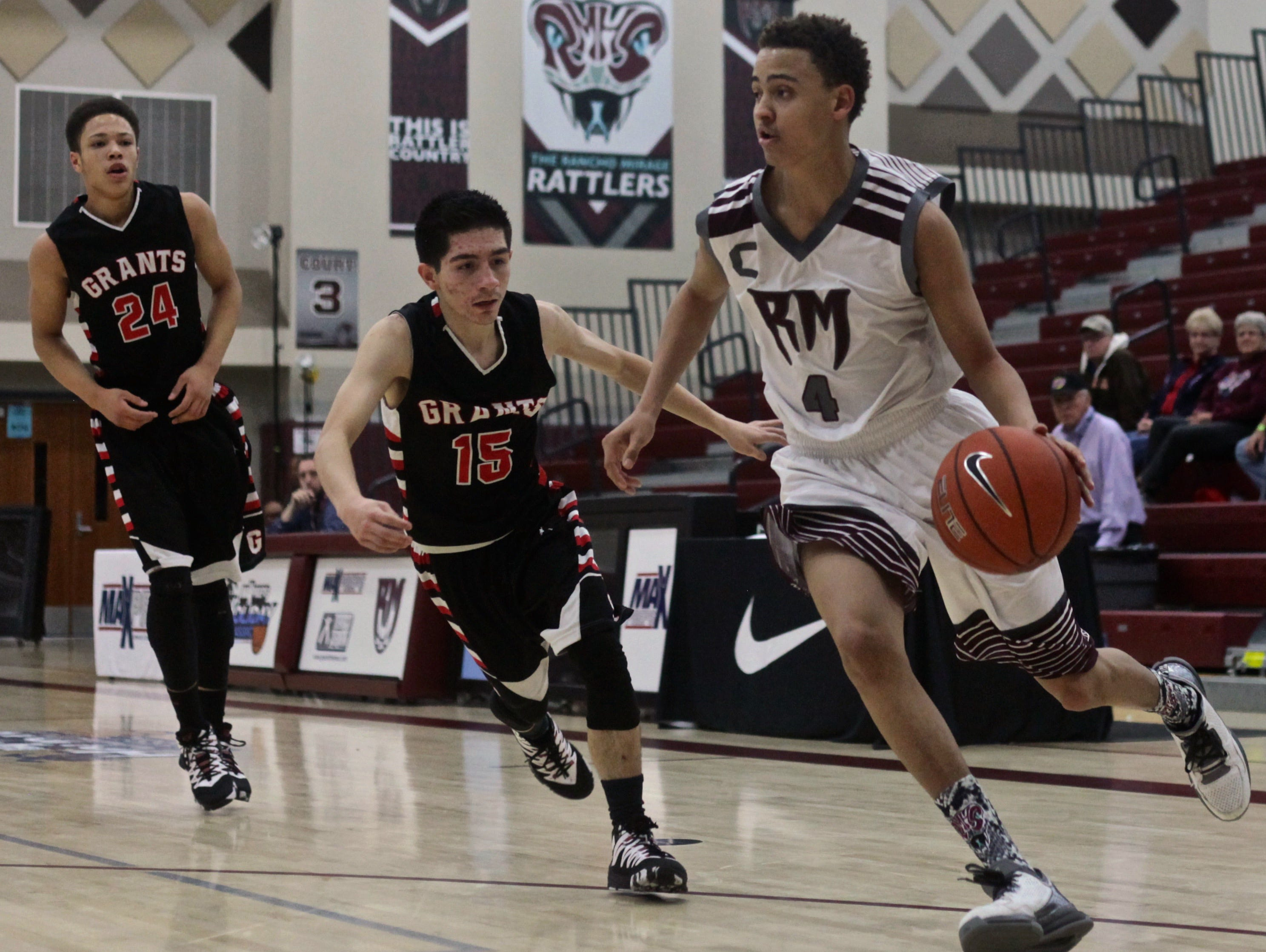 Rancho Mirage's Charles Neal (4) attempts to evade Grants' Eric Gonzales (15) during the Design Pro Division championship game of the MaxPreps Holiday Classic on Wednesday, Dec. 30, 2015.