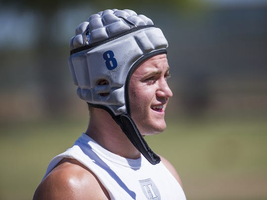 Higley High School running back Draycen Hall takes a break at practice at the school, Wednesday, May 11, 2016.