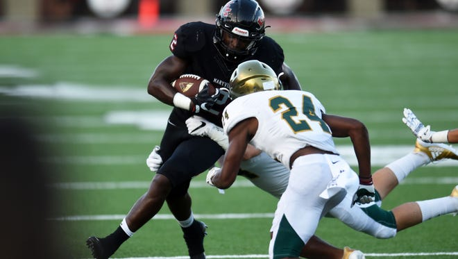 Catholic players take down Maryville's Isaiah Cobb (2) during a high school football game at Maryville High School against Knoxville Catholic High School Friday, Aug. 18, 2017.