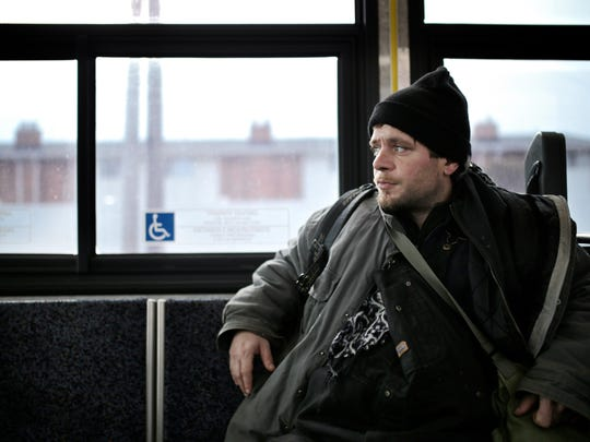 Steven Moore, 37, of Flint uses the Ride to Groceries bus to get to Walmart on Feb. 2.