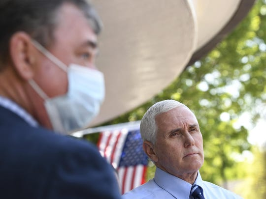 Vice President Mike Pence talks to the press, including Kevin Freking of the Associated Press, left, after delivering PPE from FEMA to Woodbine Rehabilitation and Healthcare Center in Alexandria,Va., Thursday, May 7, 2020. (AP Photo/Susan Walsh)