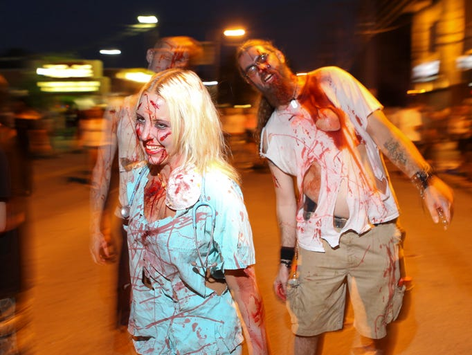 Scenes from the Louisville Zombie Attack Friday in the Highlands. Aug. 29, 2014 By Matt Stone/The C-J