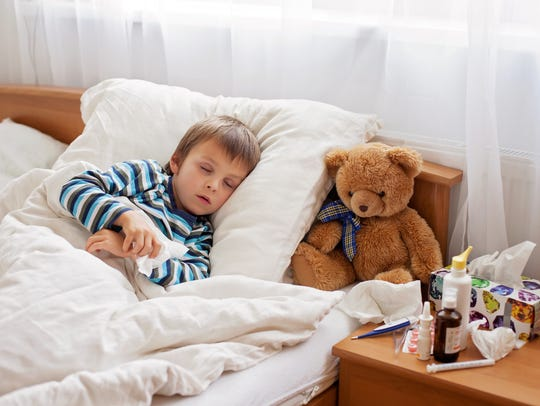A sick child resting at home.