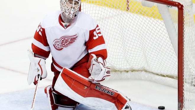 The Anaheim Ducks score past Detroit Red Wings goalie Jimmy Howard during the third period on Monday. The Ducks won 4-3 in a shootout.