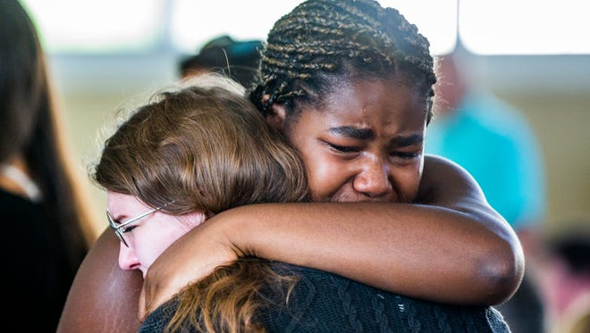 Friends and family mourn Brooke Rice, a 16-year-old St. John Neumann High School student who died in a car crash Saturday night in North Naples, during a memorial at the high school in Golden Gate on Monday, July 2, 2018.
