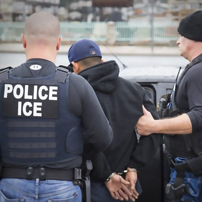 Immigration and Customs Enforcement officers detain