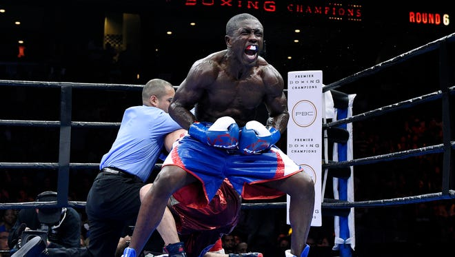 Andre Berto celebrates after knocking out Josesito Lopez in the 6 round of their 12 round welterweight bout at Citizens Business Bank Arena Friday, March 13.