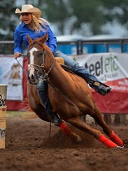 Tiany Schuster competes in the barrel racing event