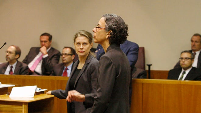 Nikki Kowalski, Deputy Soliciter General for the Attorney General's office for criminal matters, right, and Ann Marie Preissler, attorney with the AG's office, argues against dropping the charges against Robert Wiesner, seated top right, during a hearing into the LDC corruption case in Monroe County Court Wednesday, Dec. 18, 2013.