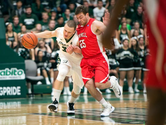 Binghamton guard J.C. Show collides with Cornell defender