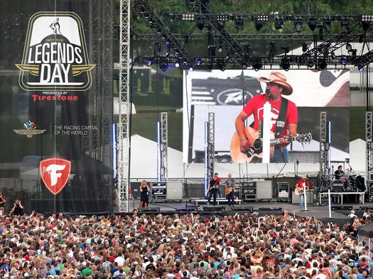 Country music star Jason Aldean performs his concert for a massive crowd at the Indianapolis Motor Speedway on Legends Day on Saturday, May 24, 2014.