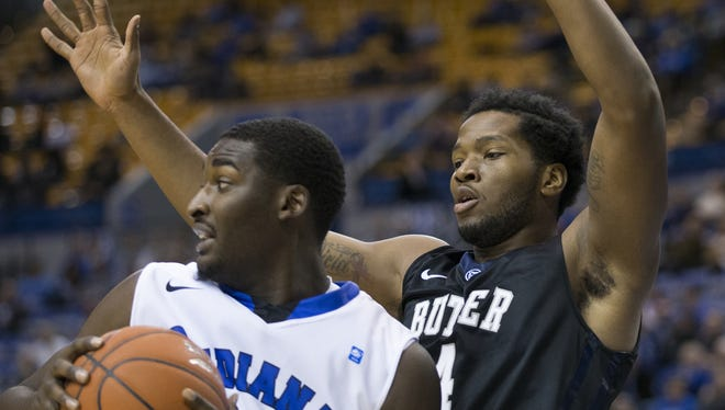 Butler plays Indiana State at noon Saturday at Hinkle Fieldhouse, the teams' 126th meeting in a series dating to 1903. In this 2014 game, Tyler Wideman, right, of Butler, defended TJ Bell of Indiana State.
