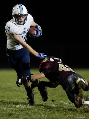 Little Chute's Dakota Farnsworth (40) dodges a tackle from Omro's Chris Hess during their WIAA Division 4 football playoff game Friday in Little Chute.