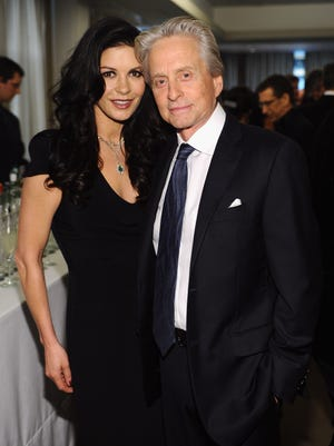 One of the last times we saw them together: Michael Douglas and Catherine Zeta Jones attend a reception on April 23, 2013 in NYC.