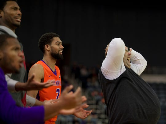 Evansville coach Marty Simmons, right, and his bench react to a non-call against the Northern Iowa Panthers at The Ford Center in Evansville Sunday afternoon. The Purple Aces beat the Panthers 70-58.