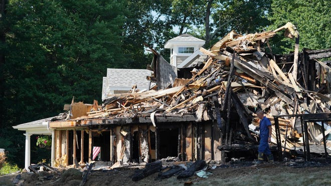 The home at 4 Butterfield Lane in Stratham was destroyed in a two-alarm fire early Monday morning.
