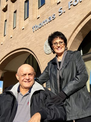 Rhonda Firestack-Harvey and her husband, Larry Harvey, appear outside federal court in Spokane, Wash., on Tuesday, March 3, 2015.  Firestack-Harvey, their son and daughter-in-law were found guilty of growing marijuana on their property. Charges against Larry Harvey were dropped shortly before trial because he's suffering from advanced pancreatic cancer. Prosecutors struck a plea bargain with the fifth member of the group, who testified he fronted the money and provided the growing expertise.