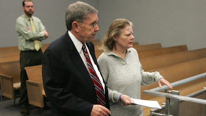 Defendant Theresa Supino arrives for trial Wednesday, Feb. 4, 2015, with her defense attorney, Steven Addington, in Waterloo, Iowa. Supino is charged with two counts of first-degree murder for allegedly killing Steven Fisher, 20, and Melisa Gregory, 17, in March 1983 near Newton. Testimony began in Waterloo in what authorities expect will be perhaps a three-week trial.