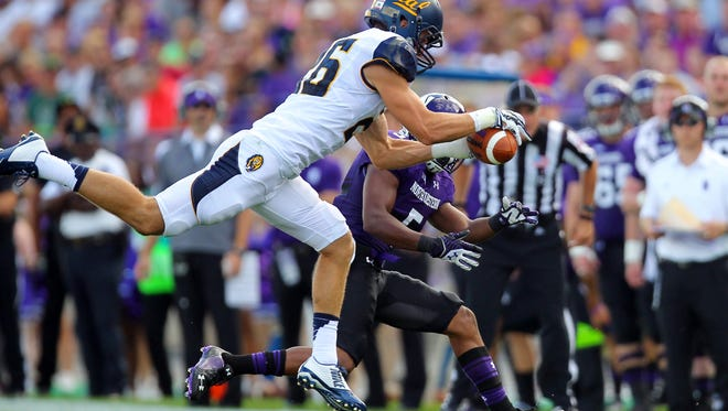 California Golden Bears safety Griffin Piatt intercepts a pass intended for Northwestern Wildcats wide receiver Miles Shuler during the first half at Ryan Field.