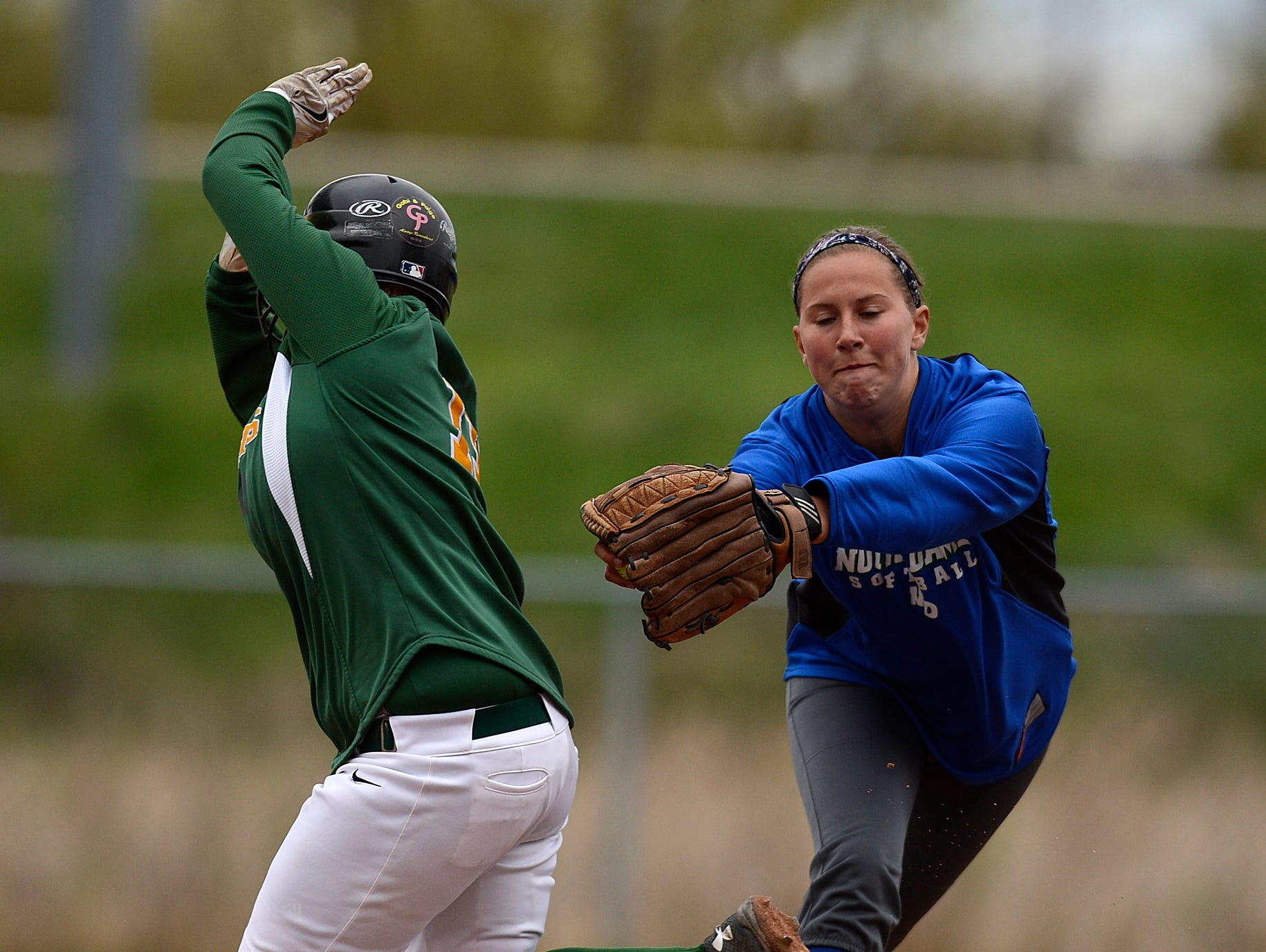 Green Bay Notre Dame second baseman Kendra Noble (9) tags out Green Bay Preble's Megan Timmers (15) during Tuesday's softball game at Riverview Park in Allouez.