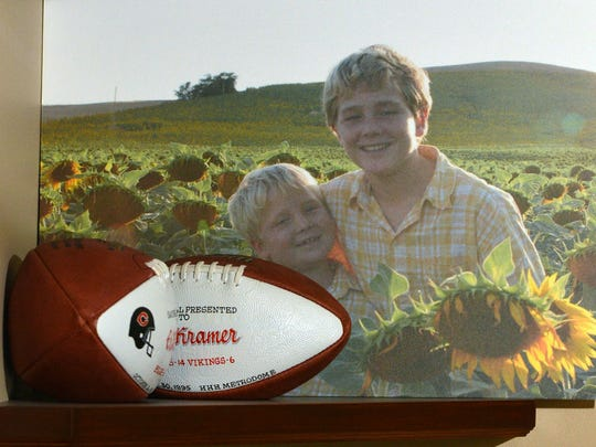 A photograph taken by Erik Kramer of his sons Dillon Kramer and Griffen Kramer on a 2005 trip to Italy rests on a shelf at his home in Agoura Hills.