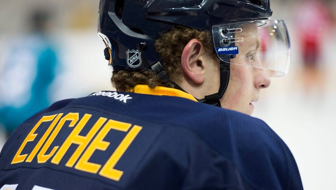 Buffalo Sabres' Jack Eichel rests on the bench during the National Hockey League Players Association (NHLPA) Rookie Showcase in Toronto, Tuesday, Sept. 1, 2015.