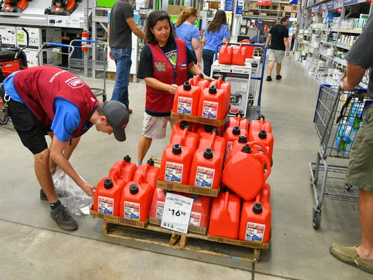In this file photo, people buy hurricane supplies at the Melbourne Lowe's Home Improvement Store on Minton Road in Melbourne, Florida.