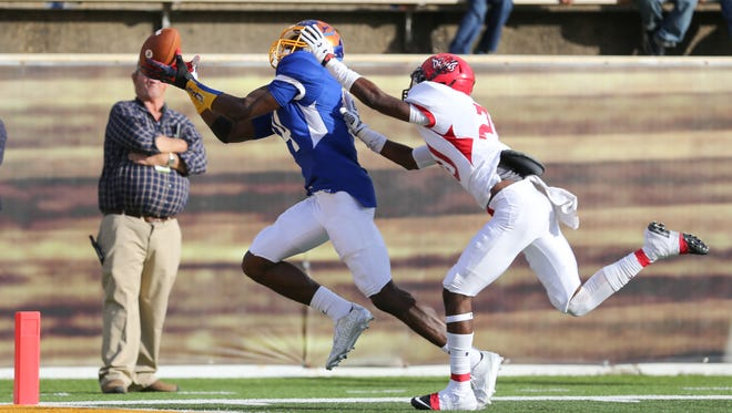 Mississippi's DeKaylin Metcalf (14) makes a touchdown catch in the second half. Mississippi defeated Alabama 28-21 in the Mississippi-Alabama All-Star Game that was played on Saturday, December 12, 2015 at the University of Southern Mississippi.