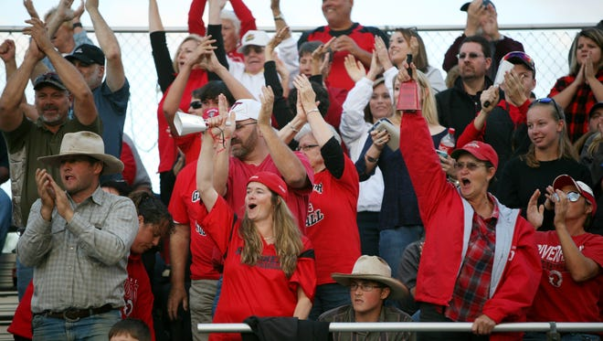 Riverheads fans cheer during the game against Buffalo Gap on Saturday, Oct. 1, 2016.