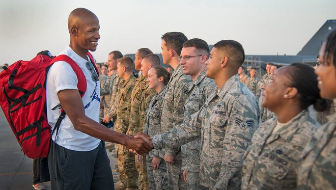Retired NBA star Ray Allen shakes hands with military members during the USO/ CJCS 2016 Holiday Visit Tour.
