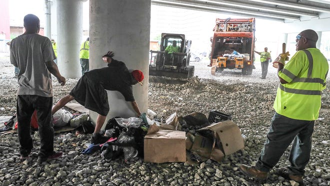 City crews were clearing out garbage July 3, 2018, at a known homeless encampment near Wayside Christian Mission, off of Jefferson and Preston Streets under Interstate 65.