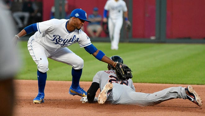 The Tigers' Niko Goodrum (28) is tagged out by Royals shortstop Alcides Escobar (2) as he tries to steal second in the fourth inning Tuesday in Kansas City, Mo.