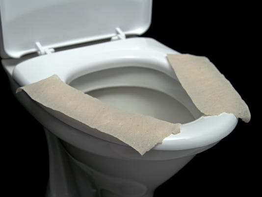 lavatory pan with toilet paper
