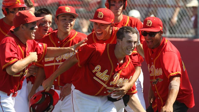 Palm Desert High School's Andrew Bash is congratulated after his home run during the team's CIF semifinal against Santa Monica on Tuesday. Palm Desert won 9-2 and will play at Dodger stadium on Friday.