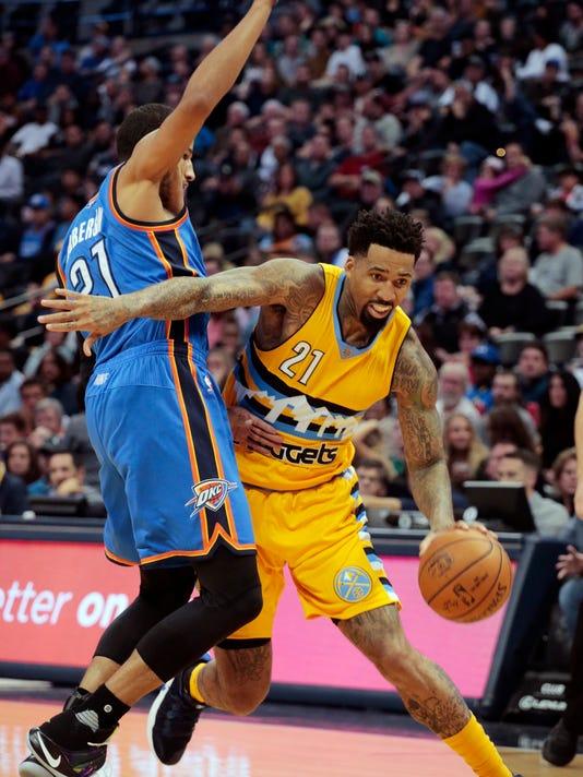 Denver Nuggets forward Wilson Chandler, right, drives past Oklahoma City Thunder forward Andre Roberson (21) in the second half of a NBA basketball game, Friday, Nov. 25, 2016 in Denver.(AP Photo/Joe Mahoney)