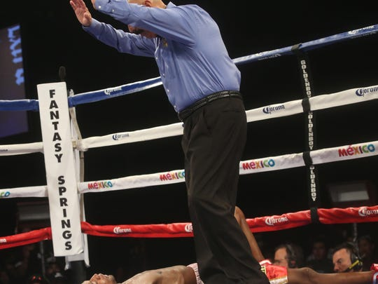 Daulis Prescott of Barranquilla, Colombia is knocked out by Tevin Farmer of Philadelphia in the eighth round during their bout at Fantasy Springs Resort Casino on Saturday.