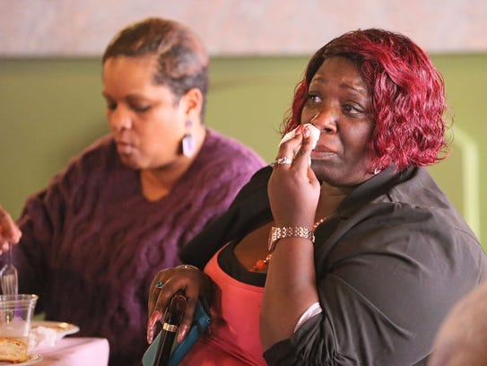 Shannon Allen of Milwaukee wipes tears at the Mother's Day brunch as she listens to Maria Hamilton describe the loss of her son Dontre Hamilton. Allen lost her son DeAndre Allen, 27, in a homicide in 2016.