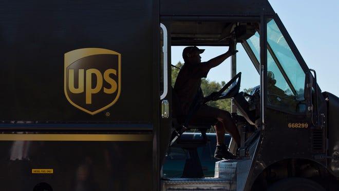 A UPS truck driver enters a company warehouse in Birmingham, Ala.